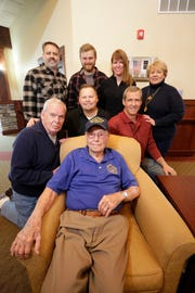 Don Harder, front, poses with his family on his 100th birthday, Friday January 18, 2019, 2019, at Pine Haven Christian Communities in Oostburg, Wis. Front row from left: Paul McCallum, Matt Hall, Scott Hall. Back row from left: Mark Hall, Justin Hall, Angela Hall and daughter Janee McCallum.