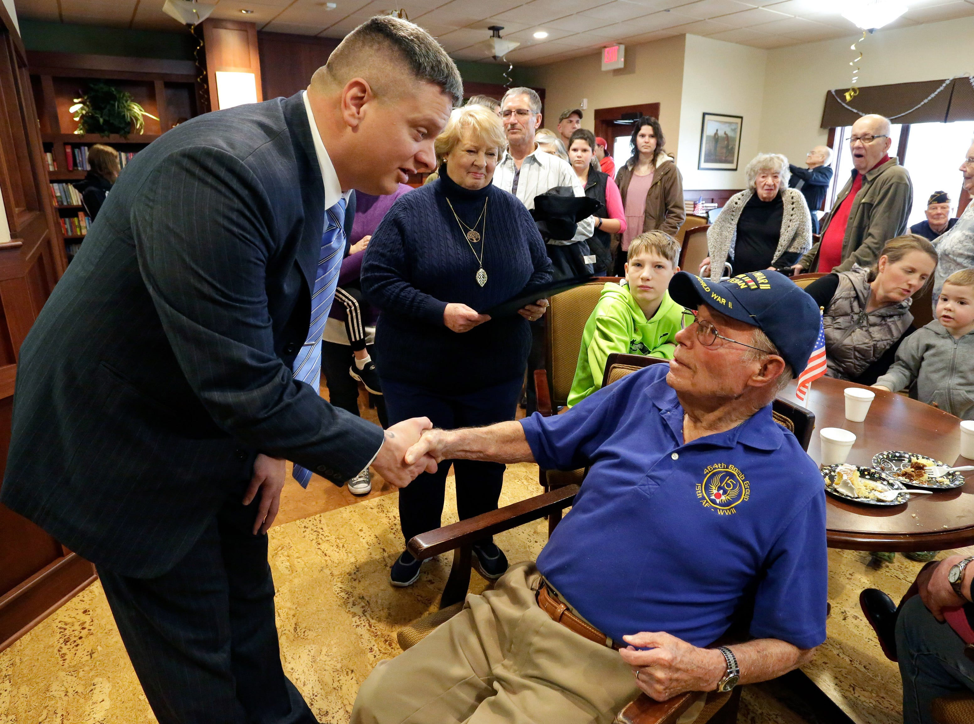 Interim Sheboygan County Veteran Service Officer Todd Richter greets World War II veteran Don Harder on his 100th Birthday, Friday January 18, 2019, 2019, at Pine Haven Christian Communities in Oostburg, Wis.
