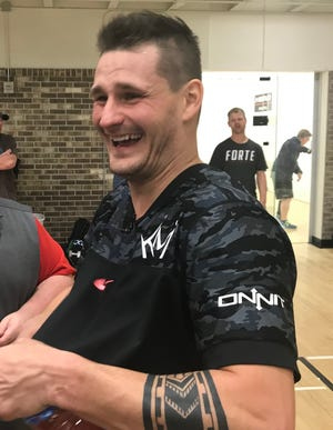 Kane Waselenchuk shares a light moment after winning the pro division of the Lewis Drug Pro/Am.