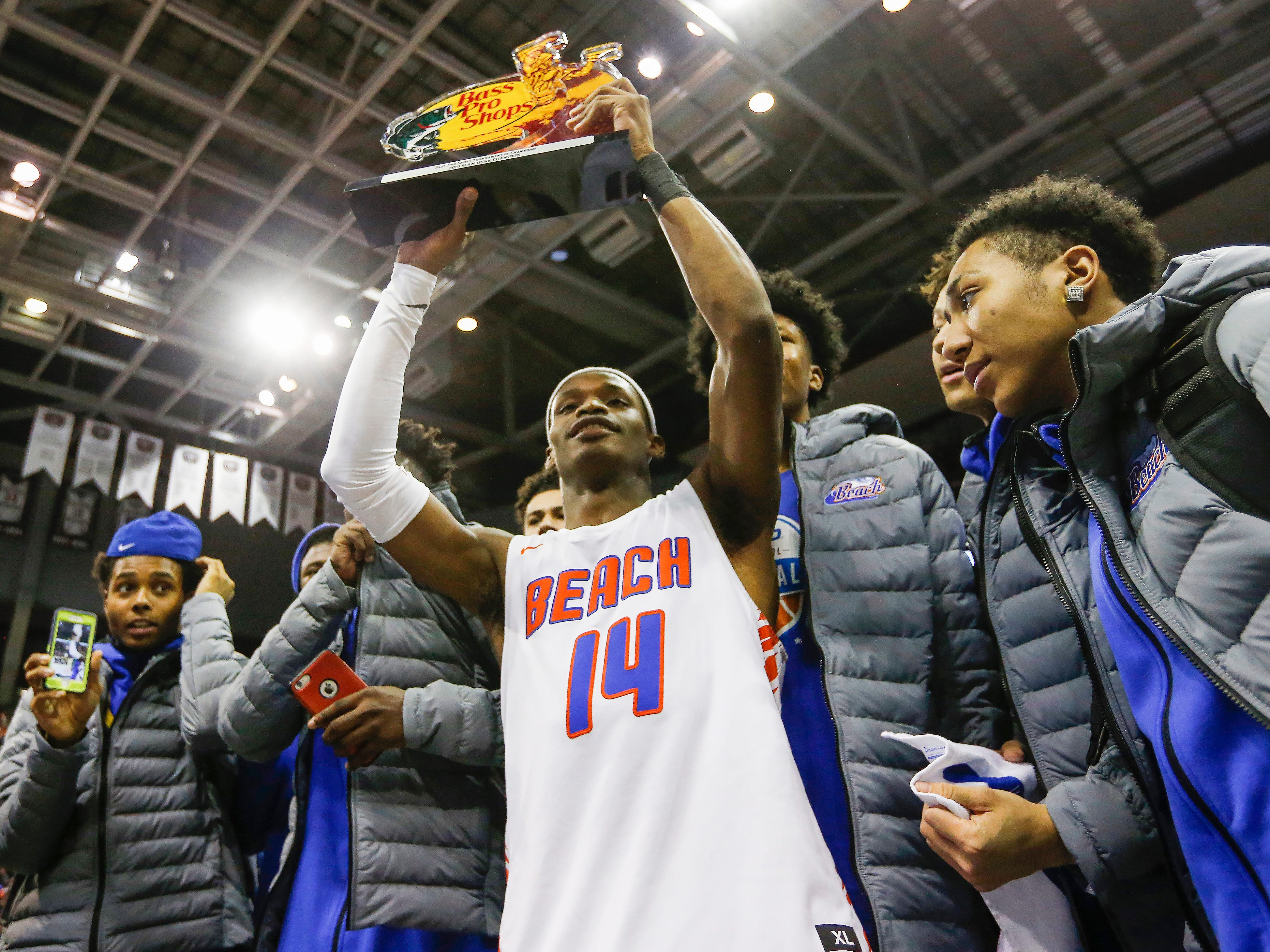 Micah Monroe, of Rainier Beach, holds up his first place trophy from the slam dunk contest at the Bass Pro Shops Tournament of Champions at JQH Arena on Saturday, Jan. 19, 2019.