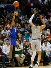 Sharife Cooper, of McEachern, hits the game winning three-pointer, in the championship game against Sunrise Christian Academy at the Bass Pro Shops Tournament of Champions at JQH Arena on Saturday, Jan. 19, 2019.