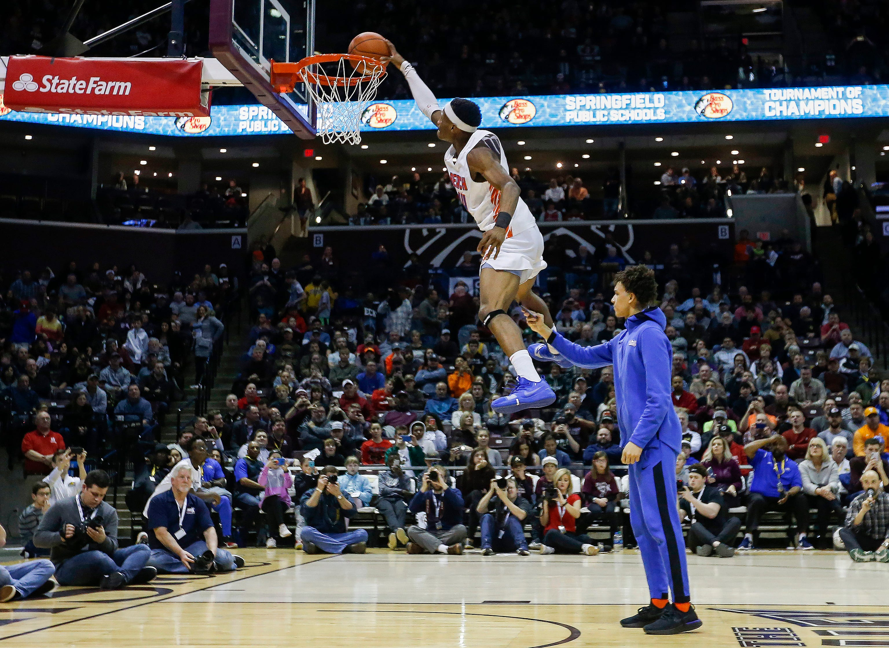 Micah Monroe, of Rainier Beach, leaps over his teammate in the slam dunk contest at the Bass Pro Shops Tournament of Champions at JQH Arena on Saturday, Jan. 19, 2019. Monroe won the contest on this dunk.