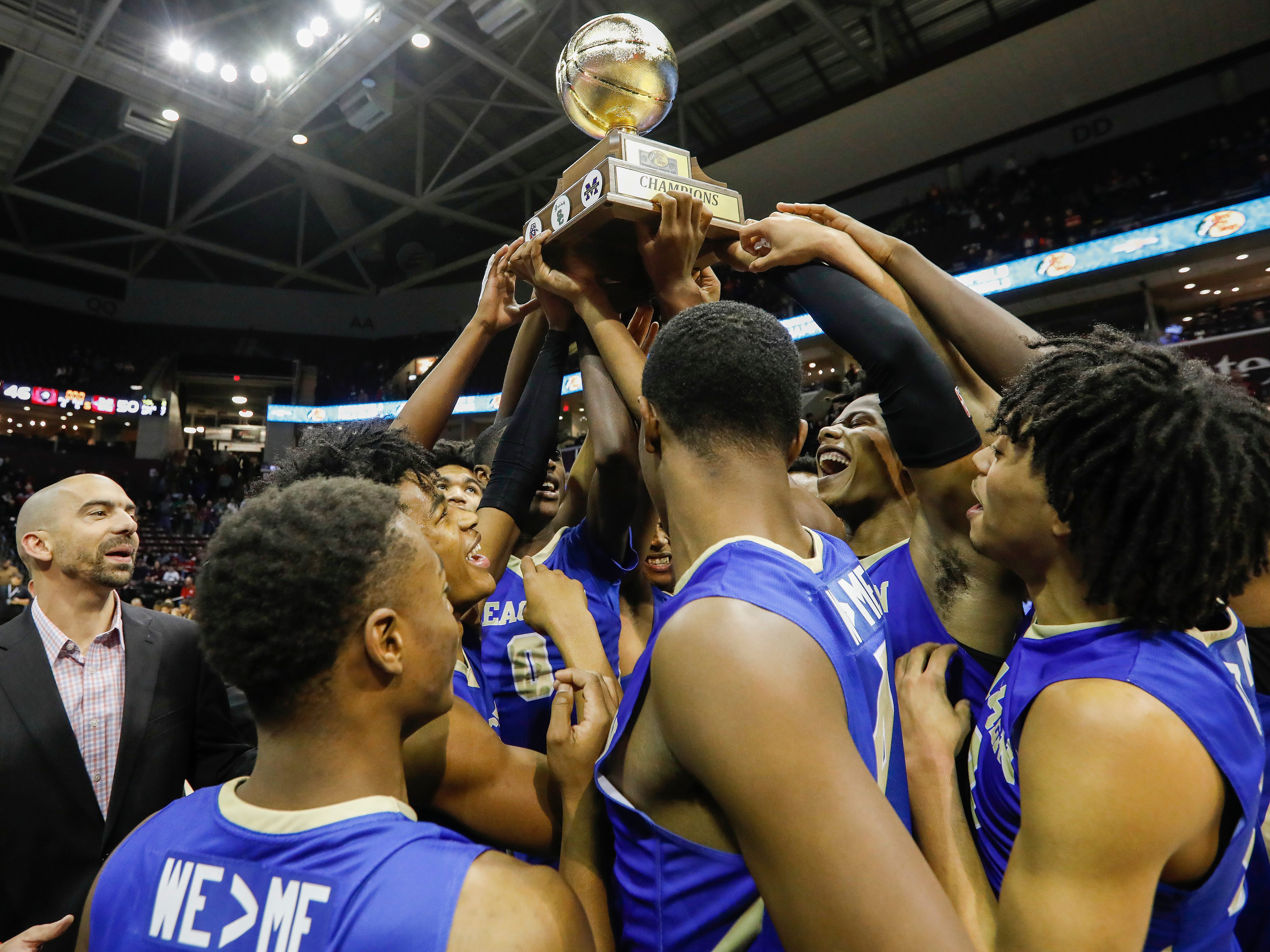McEachern celebrates their 50-46 win over Sunrise Christian Academy in the championship game of the Bass Pro Shops Tournament of Champions at JQH Arena on Saturday, Jan. 19, 2019.