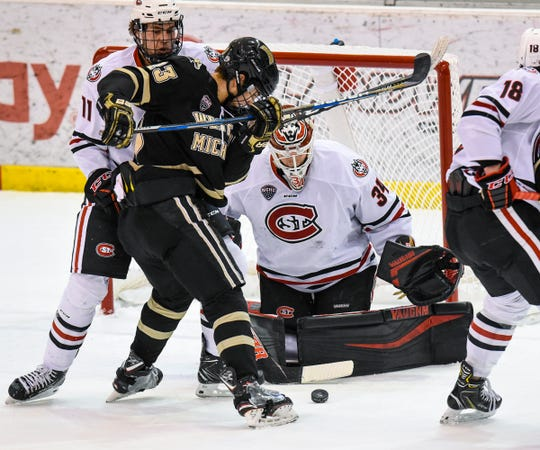 The puck skips past St. Cloud goaltender David Hrenak during the Saturday, Jan. 19, game against Western Michigan at the Herb Brooks National Hockey Center in St. Cloud.