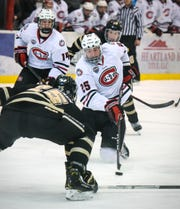 St. Cloud State's Nick Perbix controls the puck during the Saturday, Jan. 19, game at the Herb Brooks National Hockey Center in St. Cloud.
