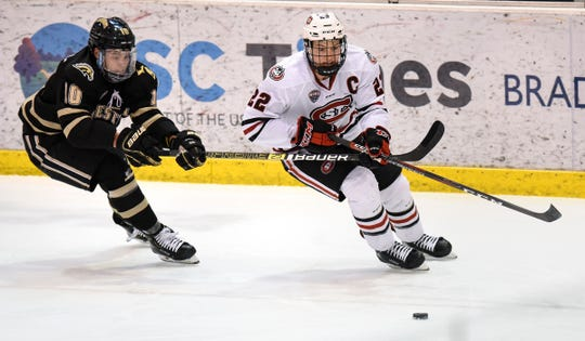 St. Cloud State's Jimmy Schuldt skates with the puck during the Saturday, Jan. 19, game at the Herb Brooks National Hockey Center in St. Cloud.