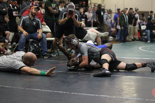 Chiles freshman Preston Scoggins can't quite secure a pin against Bartram Trail's Cathan Simpson but comes out with a 17-13 decision during a 132-pound match at the Trojan Invitational IBT.