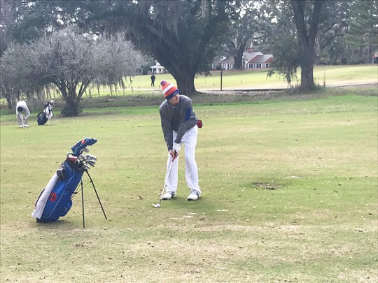 Parker Bell aims for the green on his second shot on No. 18 during the FJT at Capital City on Sunday, Jan. 20.