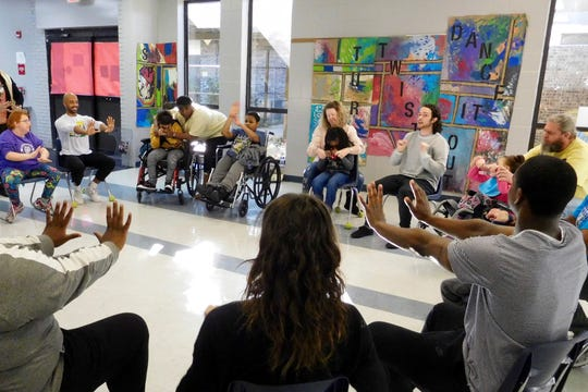 During workshops, dancers and students are seated so everyone can participate in the same way