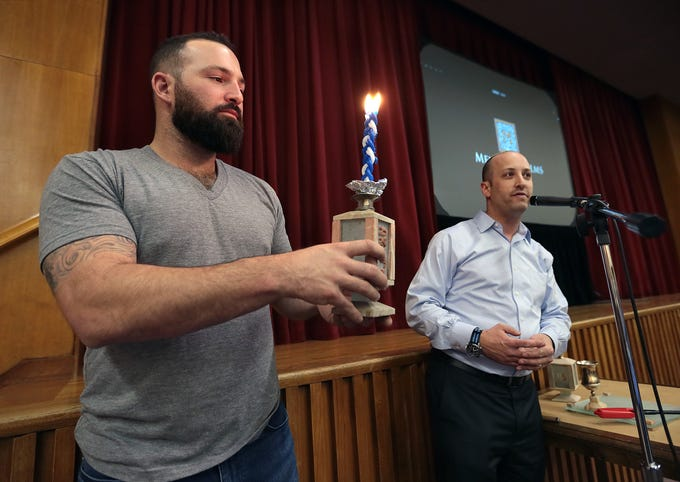 Cody Decker is visiting El Paso to show his film 'Heading Home: The Tale of Team Israel' and to host a pair of hitting clinics at Southwest University Park. Saturday, Decker introduced the documentary at Temple Mt. Sinai to the delight of El Paso's Jewish community and several Cody Decker fans. Above, Decker helps Rabbi Ben Zeidman close out the Sabbath before showing his film.