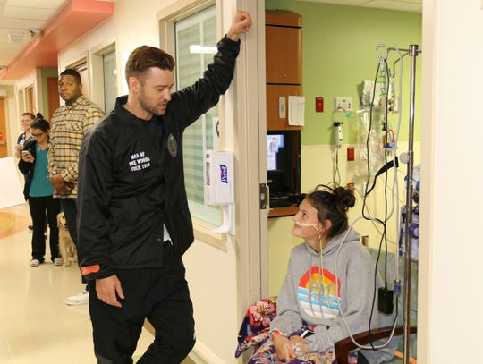 This photo provided by HCA Healthcare's Methodist Children's Hospital shows Justin Timberlake visiting patients at the San Antonio hospital on Jan. 18, 2019.