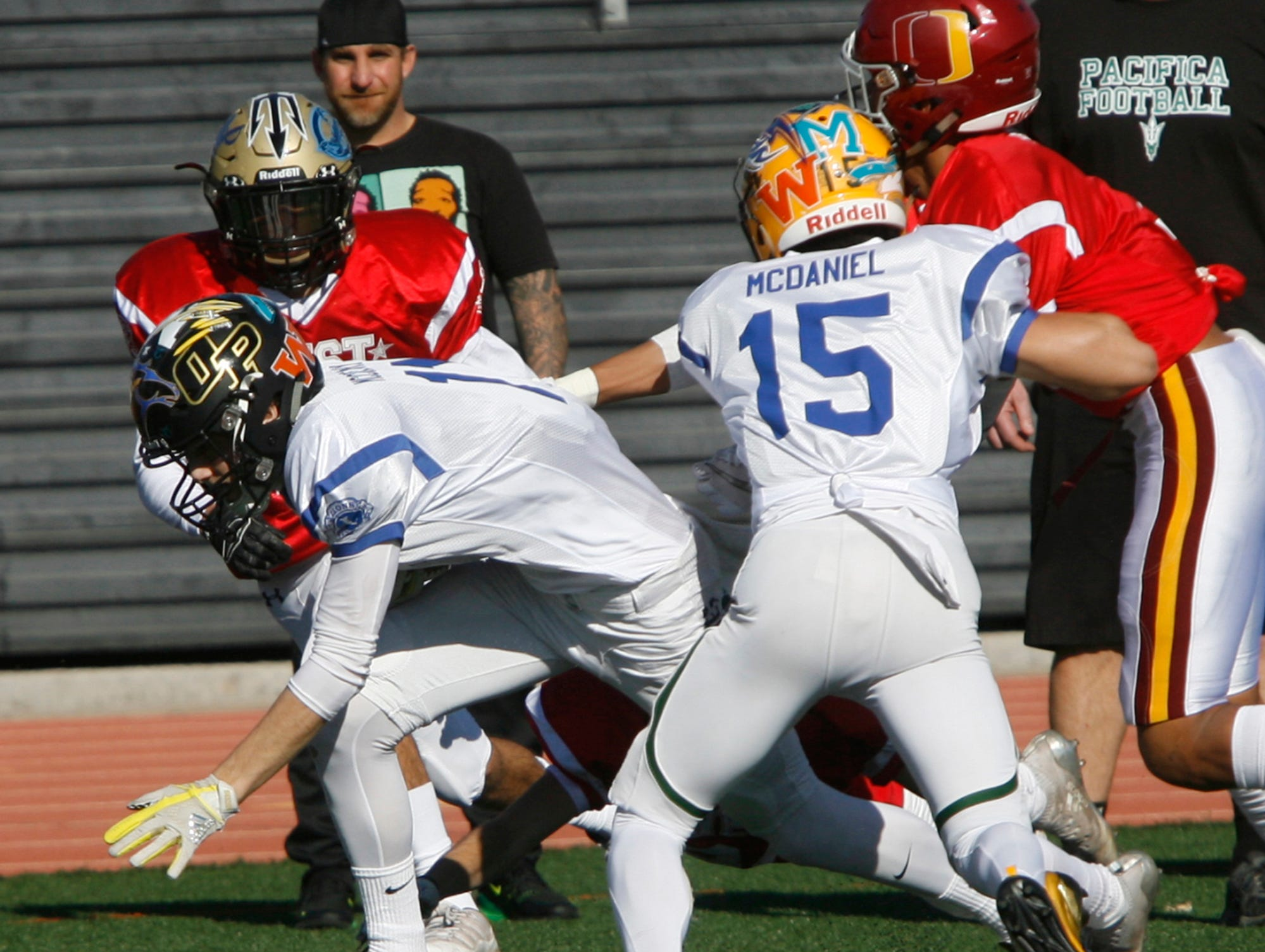 East All-Star wide receiver Cole McCreary claws his way past the West All-Star defense to score a touchdown during the West's 35-24 victory in the 46th annual Ventura County High School All-Star Football Game at Ventura College on Saturday.