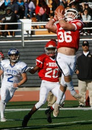 West All-Star linebacker Drew Carter intercepts a pass during the West's 35-24 victory in the 46th annual Ventura County High School All-Star Football Game at Ventura College on Saturday.