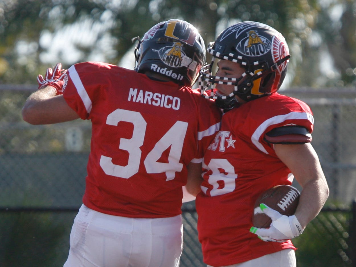 After scoring a touchdown for the West All-Stars, running back Noah Conboy celebrates with Moses Marsico during the West's 35-24 victory in the 46th annual Ventura County High School All-Star Football Game at Ventura College on Saturday.