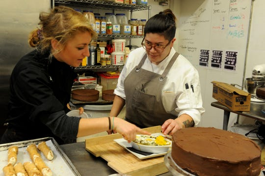 Anastashia Chavez (left), pastry chef,  and Jacky Bui, executive chef, discuss the shakshuka dish that is included on the new weekend brunch menu at 2686 Kitchen in Ventura. The menu also offers savory-sweet options like Middle Eastern spiced fried chicken paired with donut holes.