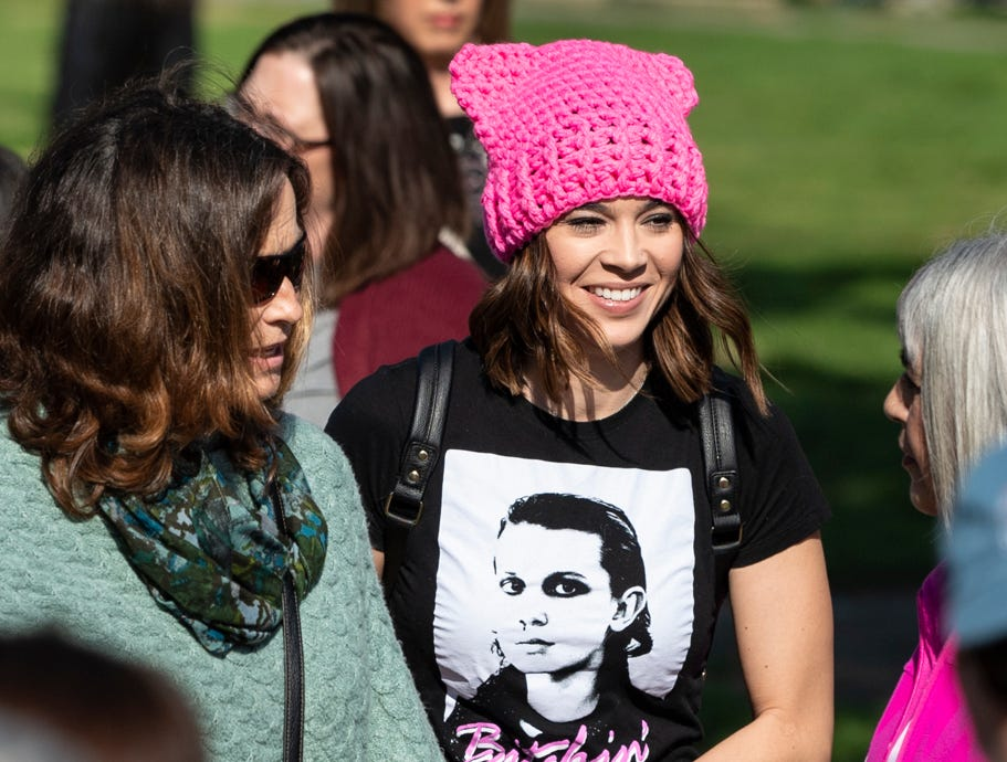 Courtney Collishaw-Mendoza, center, and others gather at Oval Park in Visalia before the Women's March on Saturday, January 19, 2019.