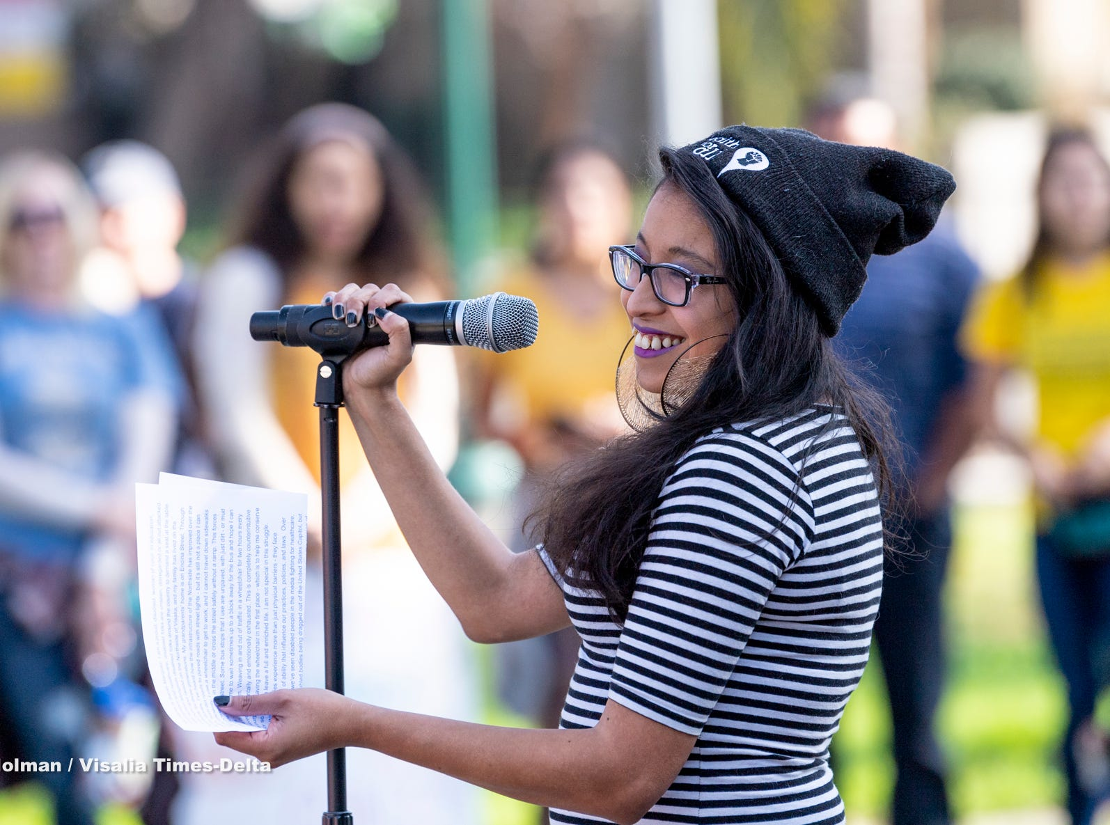 Sarah Marquez of Visalia speaks at Oval Park after the Women's March in Visalia on Saturday, January 19, 2019.