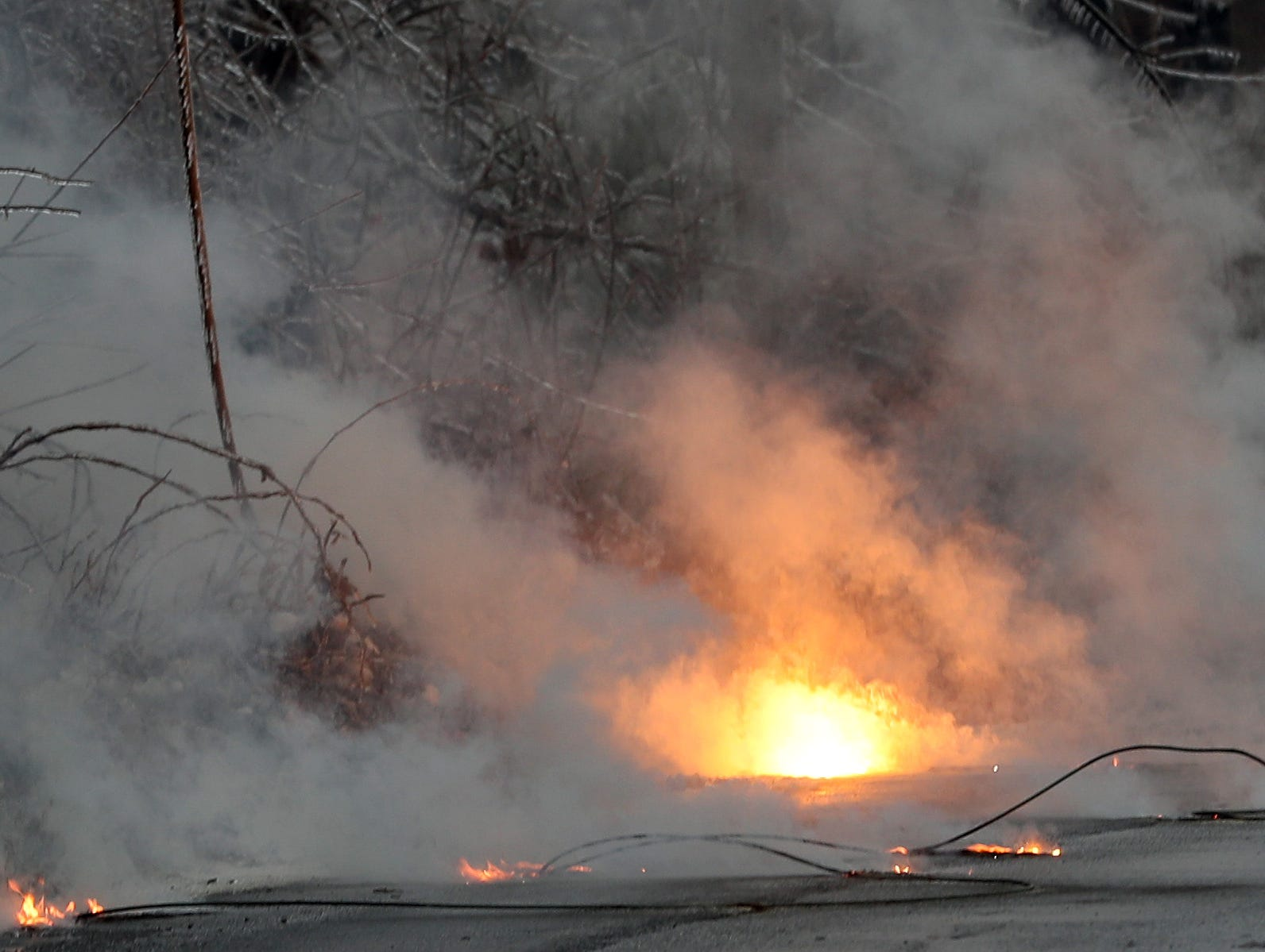 Burning power lines on the side of Route 121 in North Salem Jan. 20, 2019. A large tree branch came down taking the power lines with it.