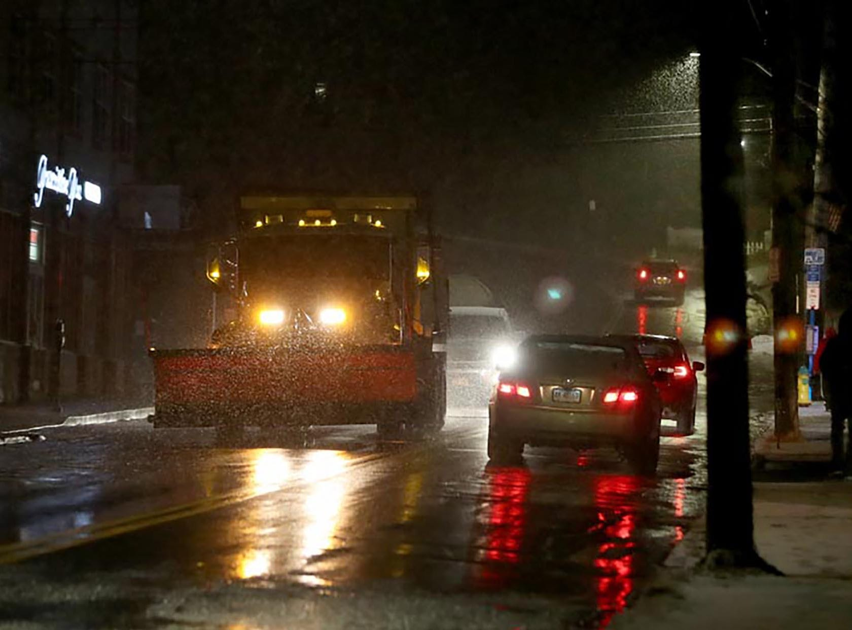 As the snow starting falling around 9:30 pm, a Village of Ossining Highway Department truck spread salt on Croton Ave. Saturday.