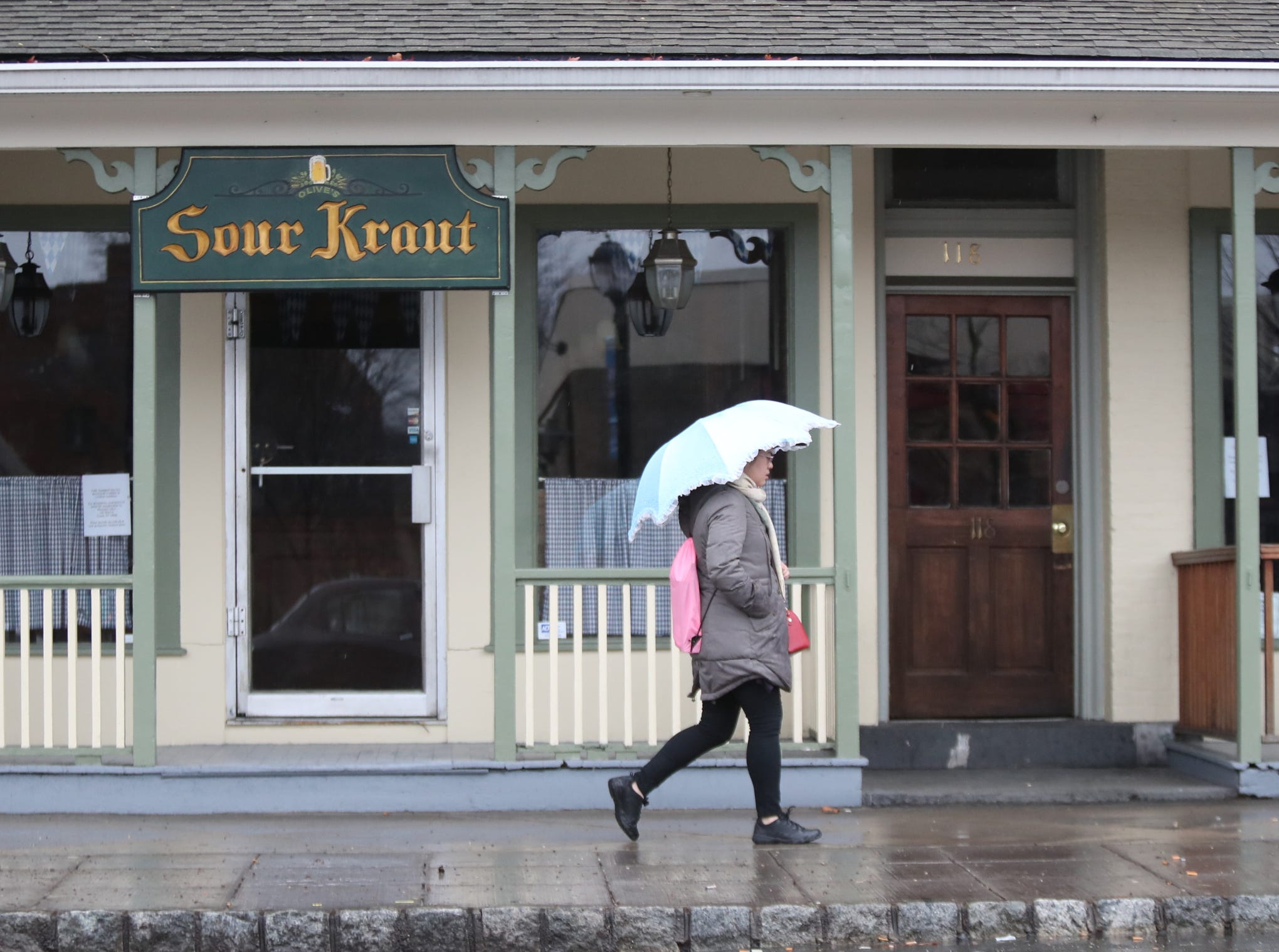 People walk with umbrellas along Main St. in Nyack on Sunday, January 20, 2019.