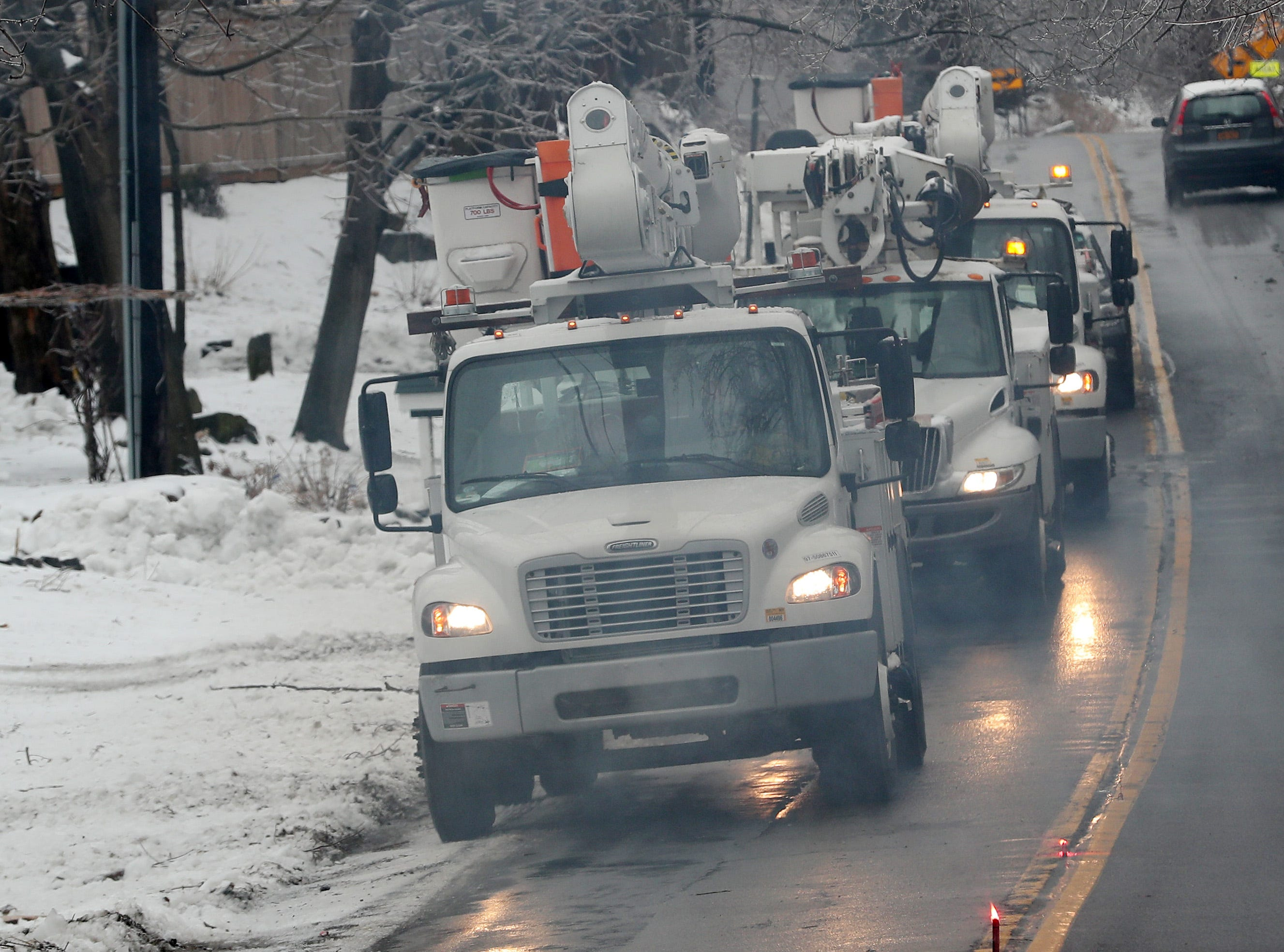 Utility crews from Northline Utilities travel along Route 121 in North Salem Jan. 20, 2019. Northline Utilities is based in Au Sable Forks, N.Y., and had crews working in the area to assist NYSEG.