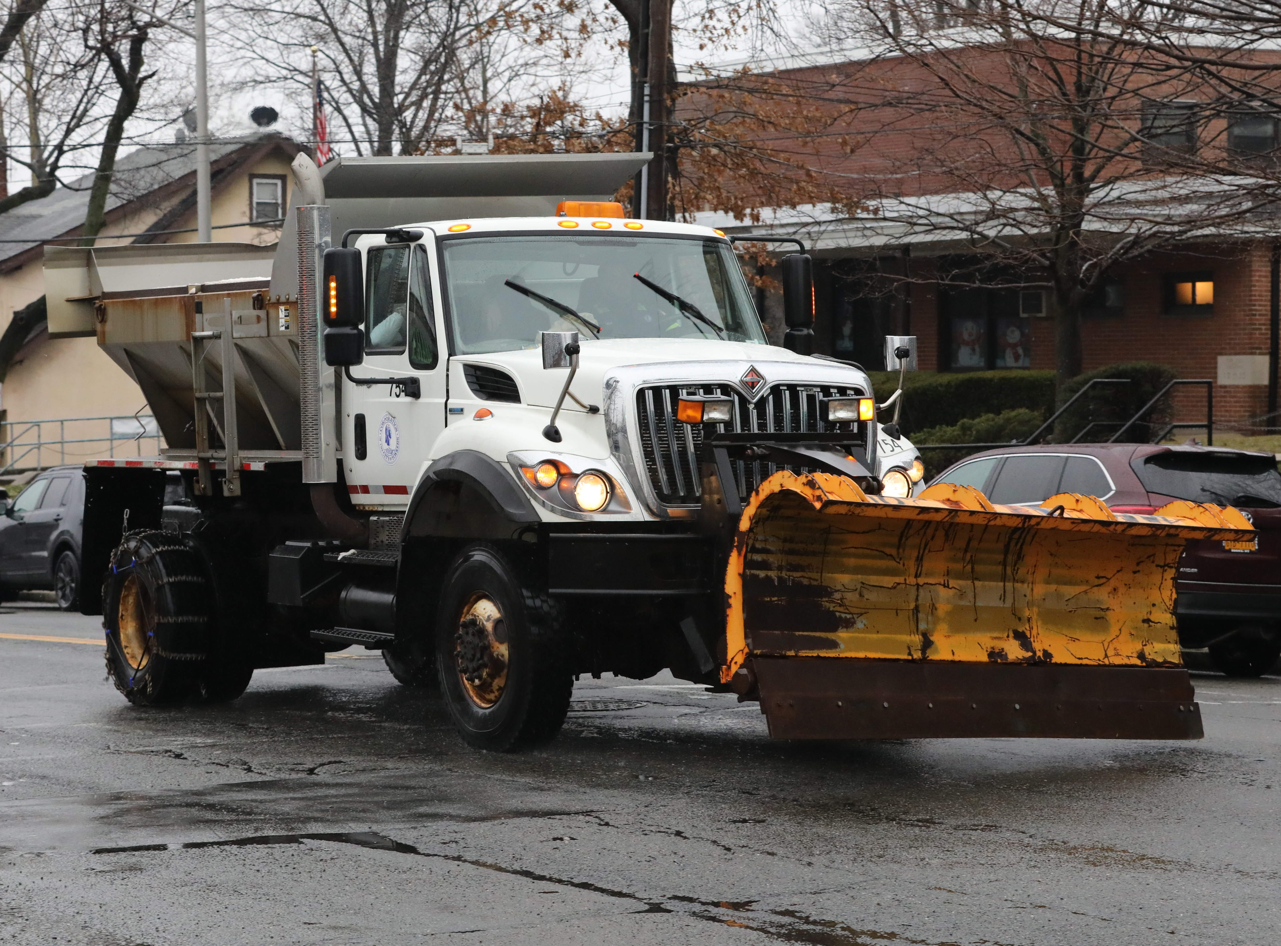 A city of Yonkers snowplow meanders along Yonkers Avenue with little to do, Jan. 20, 2019. Southern Westchester experienced more rain than snow in this latest snowstorm.
