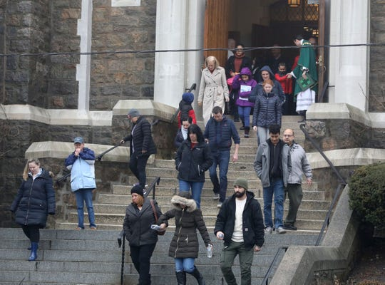 Church goers leave the 9:30 a.m. Mass at Saint John The Baptist Parish on Yonkers Avenue in Yonkers, under a light drizzle of rain, Jan. 20, 2019. Southern Westchester experienced more rain than snow in this latest snowstorm.