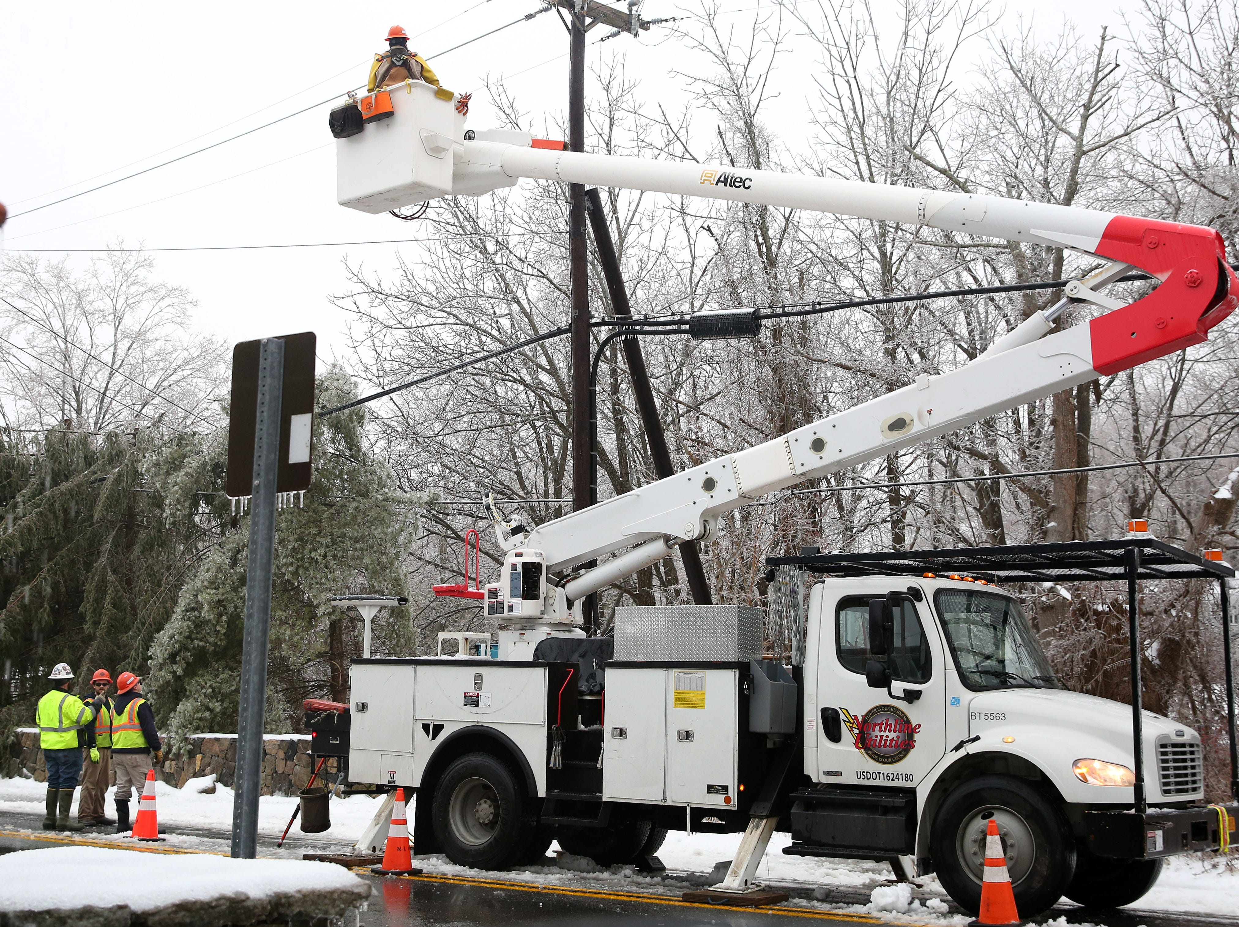 Utility crews with Northline Utilities work on  power lines at  Route 121 and Dingle Ridge Road in North Salem Jan. 20, 2019. Northline Utilities is based in Au Sable Forks, N.Y., and had crews in working in the area to assist NYSEG.