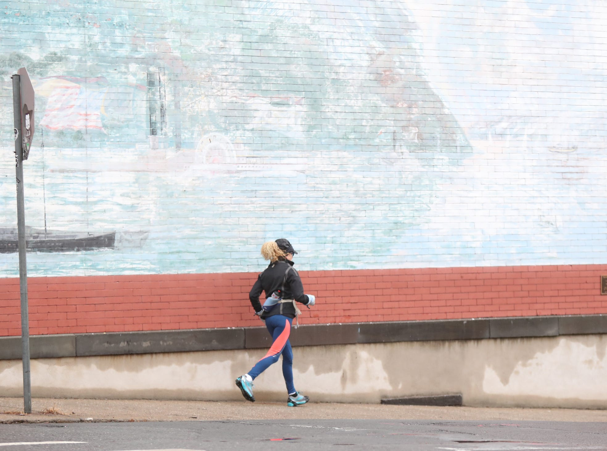 A women jogs down Burd St. in a light rain in Nyack on Sunday, January 20, 2019.