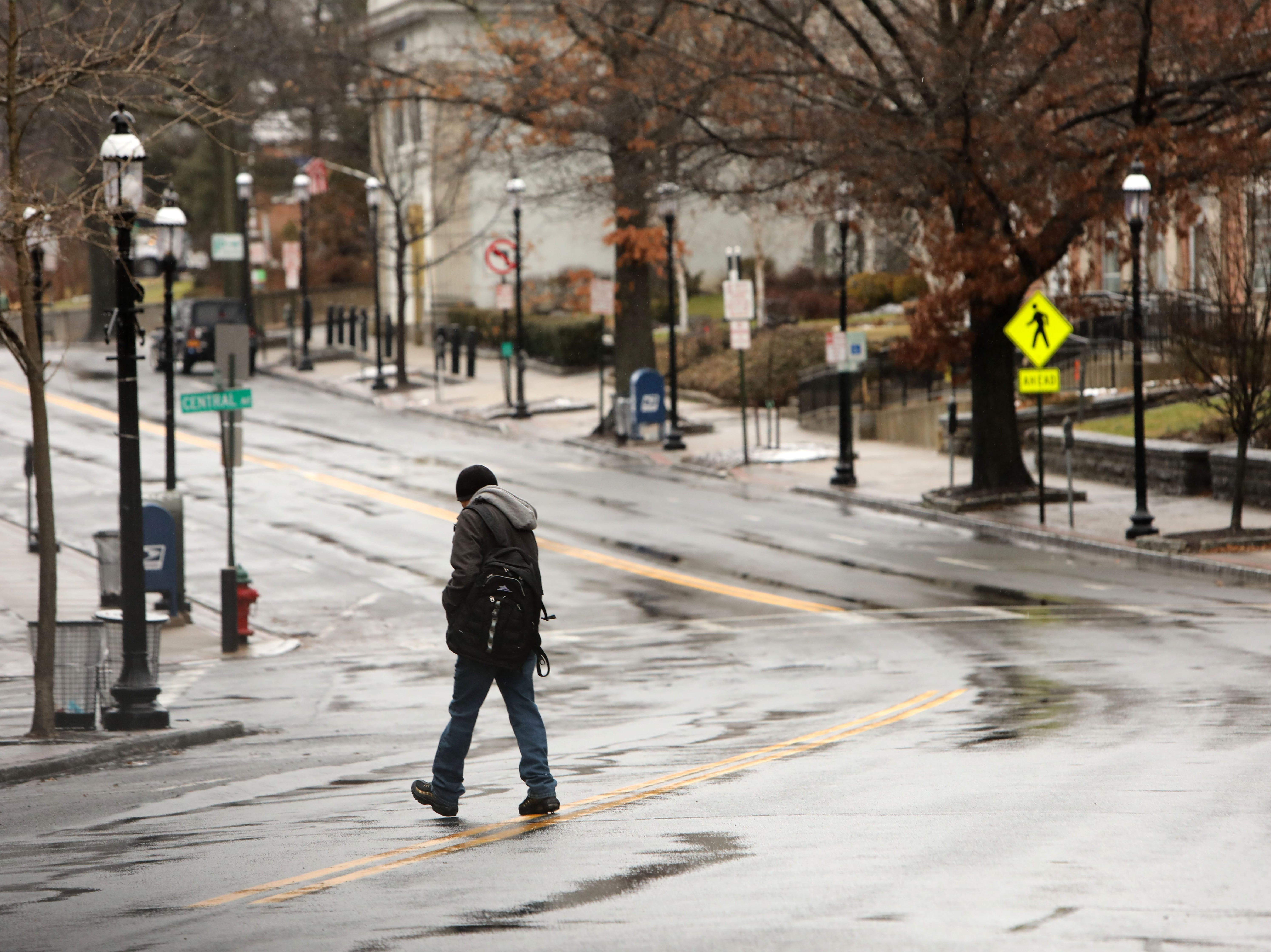 A man crosses Broadway on a quiet rainy morning Jan. 20, 2019 in Tarrytown.  Snow turned to sleet or heavy rain overnight and will continue throughout the day. Colder temperatures are expected later in the day which will cause a flash freeze throughout the region.