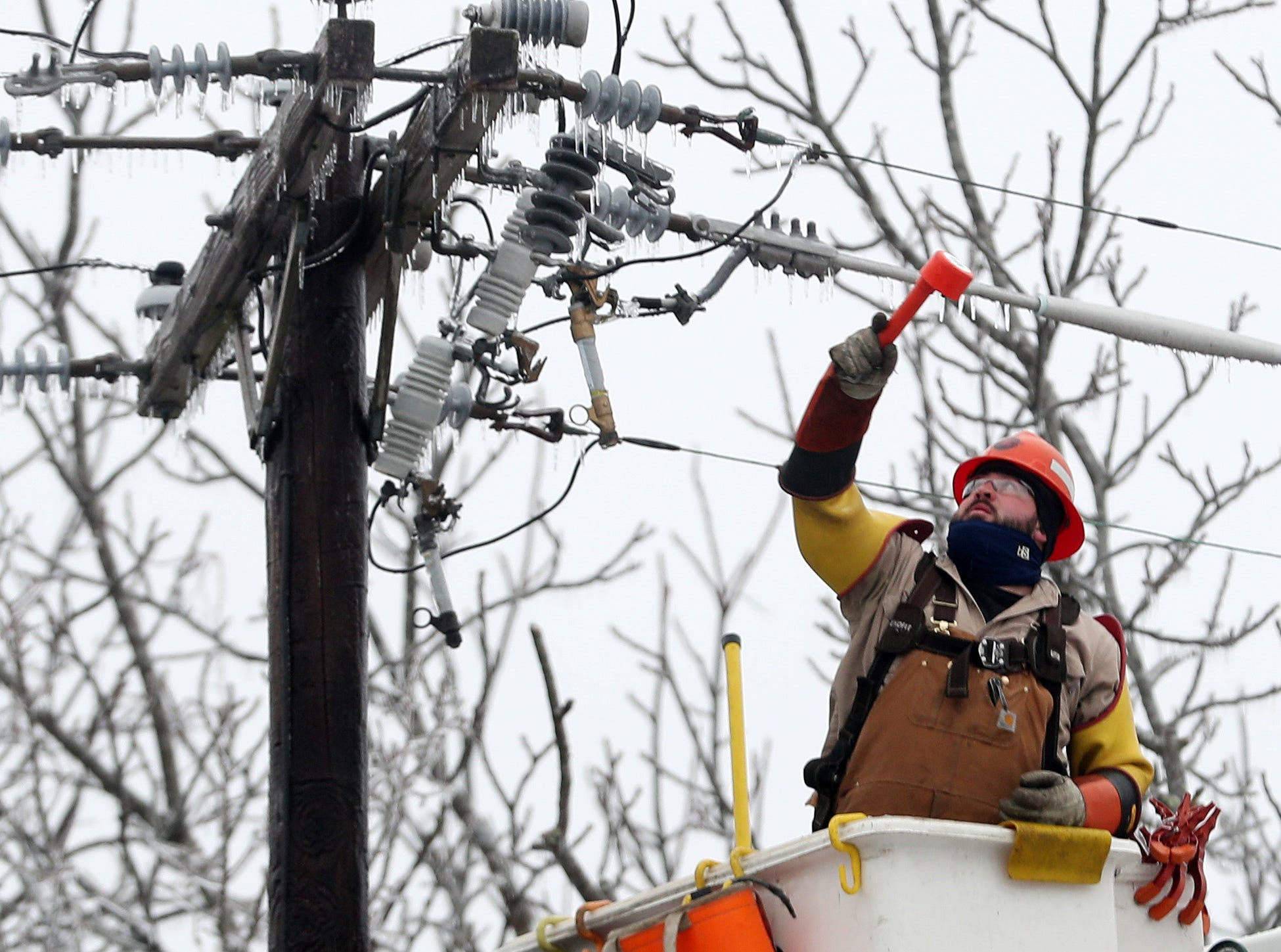 A lineman with Northline Utilities works on  power lines at  Route 121 and Dingle Ridge Road in North Salem Jan. 20, 2019. Northline Utilities is based in Au Sable Forks, N.Y., and had crews working in the area to assist NYSEG.