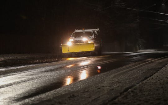 A truck with a plow drives along Little Tor Rd. in New City in the early morning hours on Sunday, January 20, 2019.