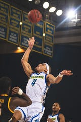 Delaware guard Darian Bryant goes up for two against Towson Saturday at the Carpenter Center.