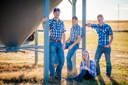 The Peterson Farm Bros (from left) Kendall, Nathan and Greg, along with their sister Laura, create music and educational videos to help promote agriculture and educate people about farming. The Peterson farm is located in central Kansas.