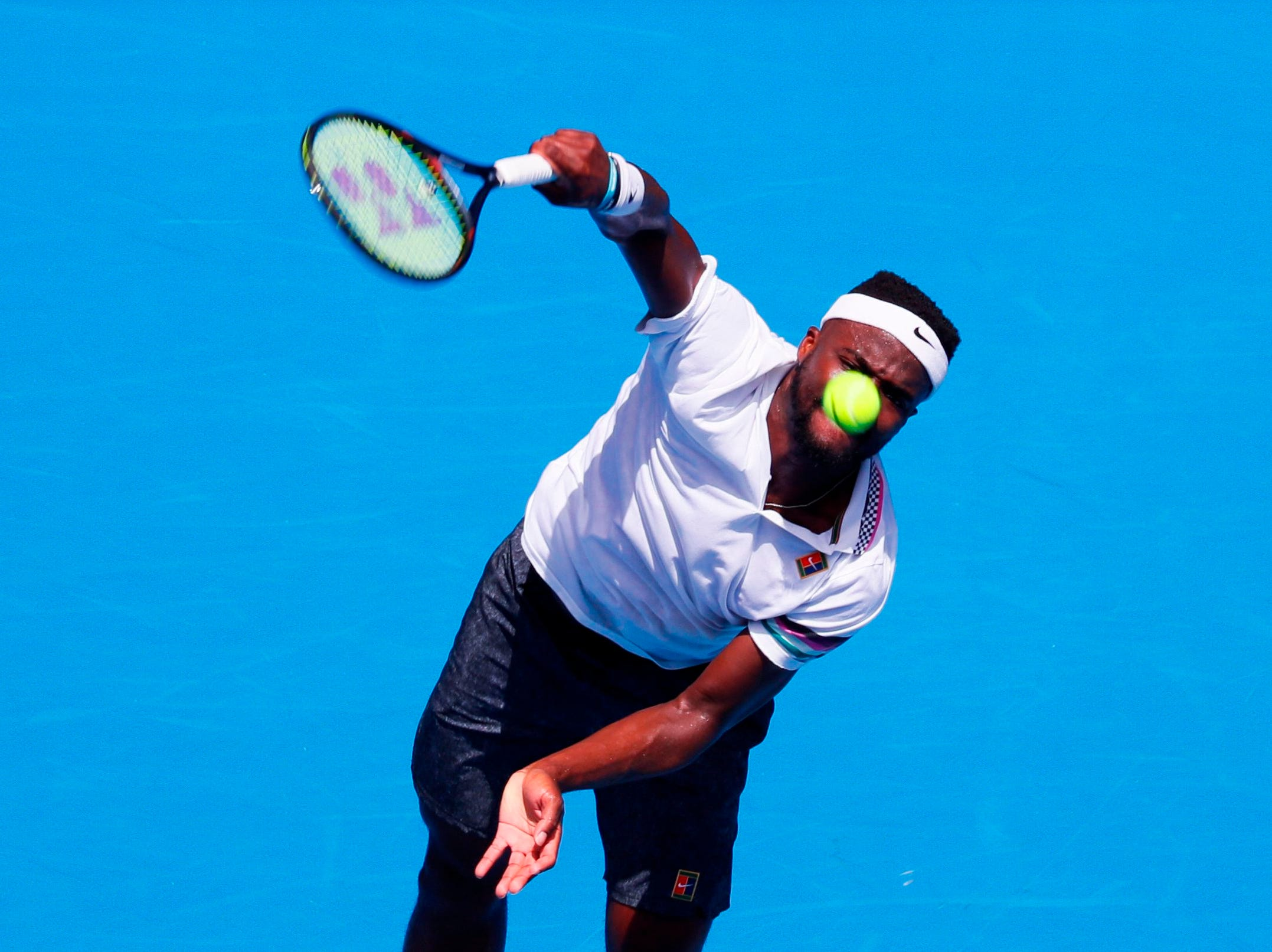 Frances Tiafoe of the USA serves against Bulgaria's Grigor Dimitrov during their men's singles match.