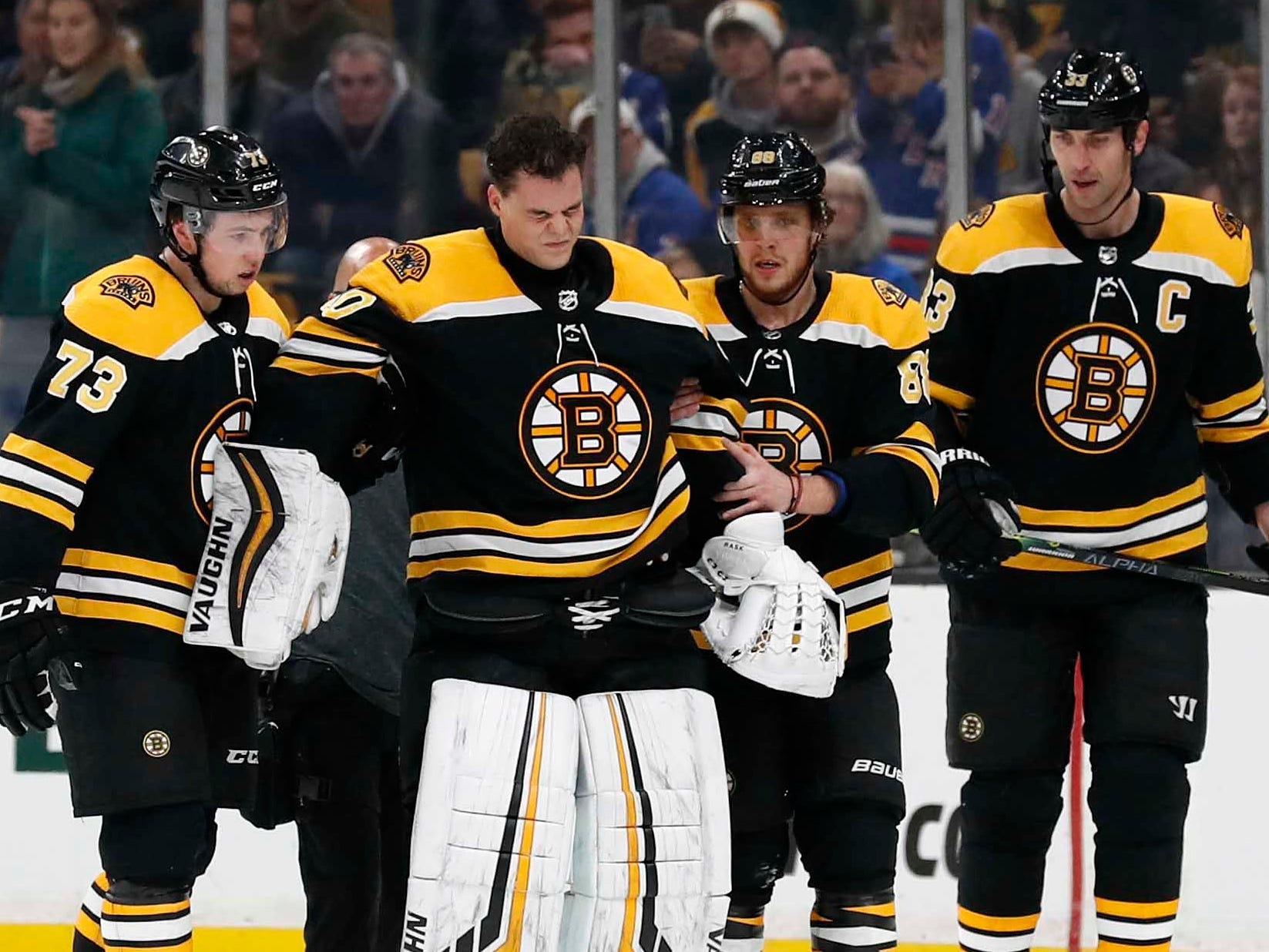 Jan. 19: Boston Bruins goaltender Tuukka Rask is helped off the ice after he was in a collision with New York Rangers center Filip Chytil. The Bruins said he suffered a concussion.