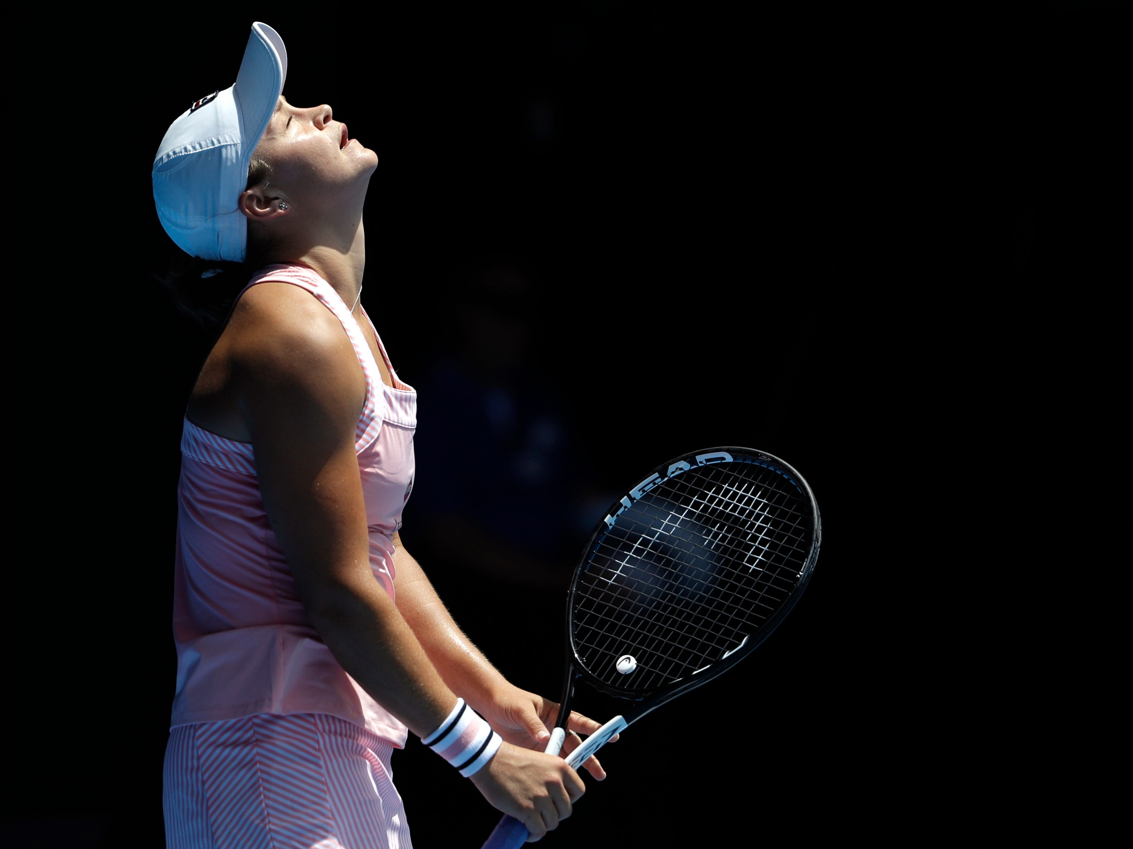Australia's Ashleigh Barty reacts after losing a point to Russia's Maria Sharapova.