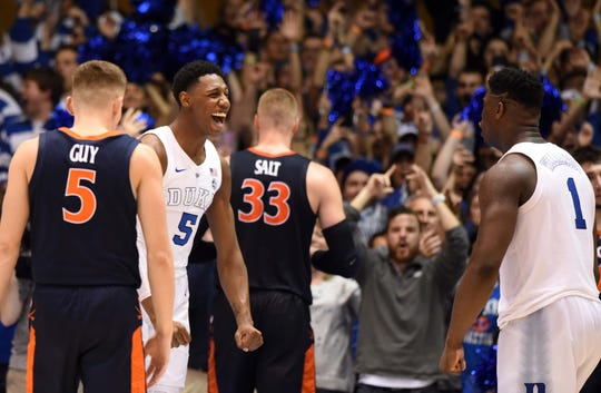 Duke Blue Devils forward R.J. Barrett (5) and Duke Blue Devils forward Zion Williamson (1) celebrate a win against the Virginia Cavaliers at Cameron Indoor Stadium. The Blue Devils won 72-70.