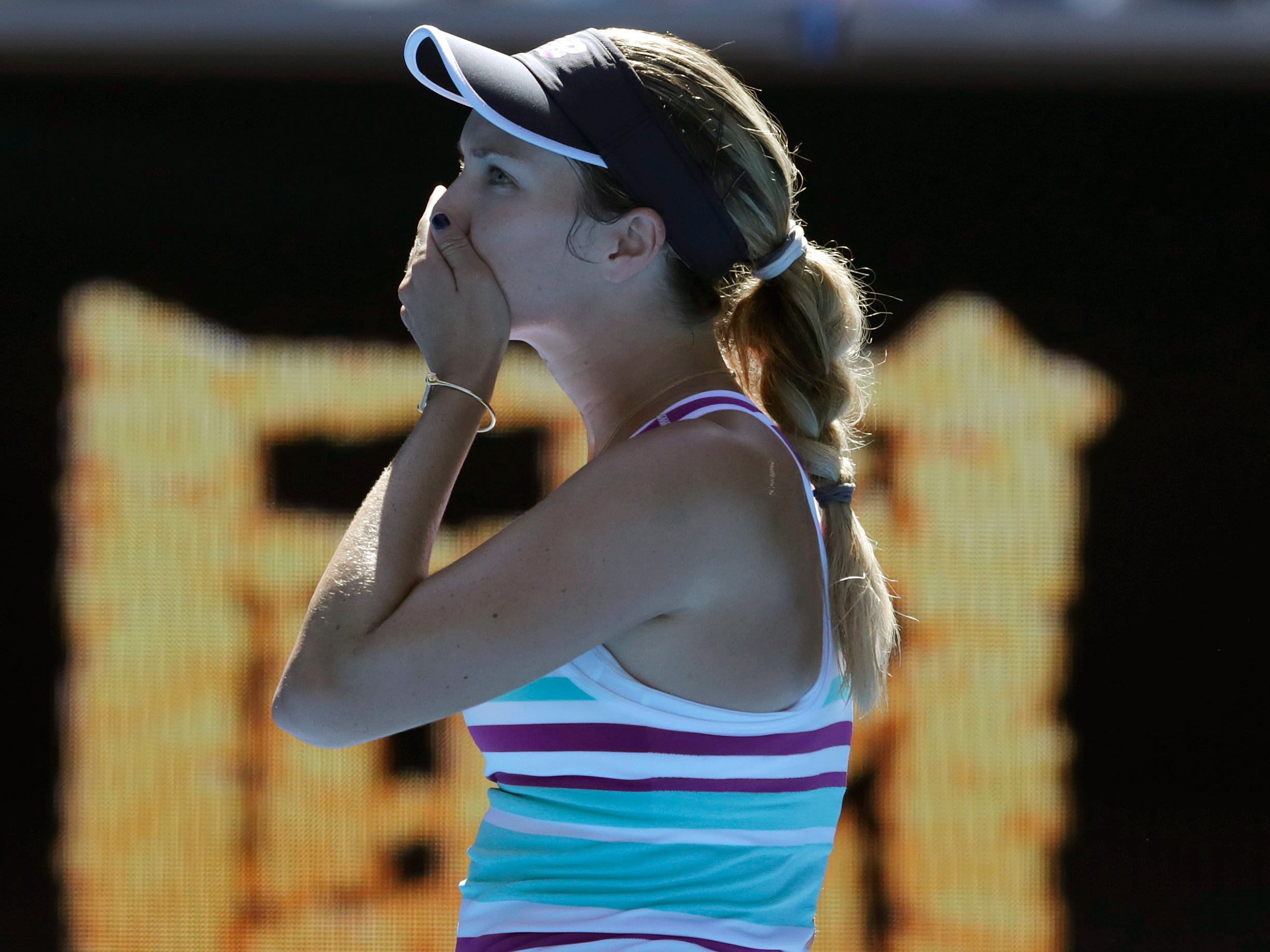 Danielle Collins celebrates after beating second-seeded Angelique Kerber to reach the quarterfinals.