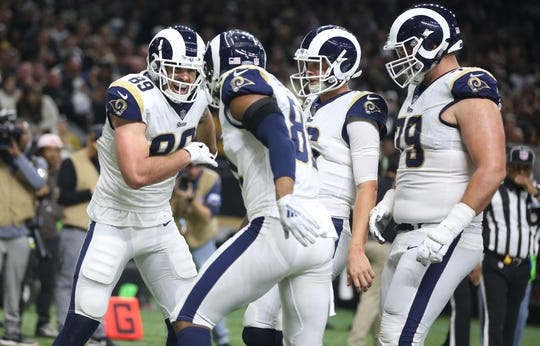 Los Angeles Rams tight end Tyler Higbee (89) celebrates with tight end Gerald Everett (81) and quarterback Jared Goff (16) and offensive tackle Rob Havenstein (79) after scoring a touchdown against the New Orleans Saints during the third quarter of the NFC Championship game at Mercedes-Benz Superdome.