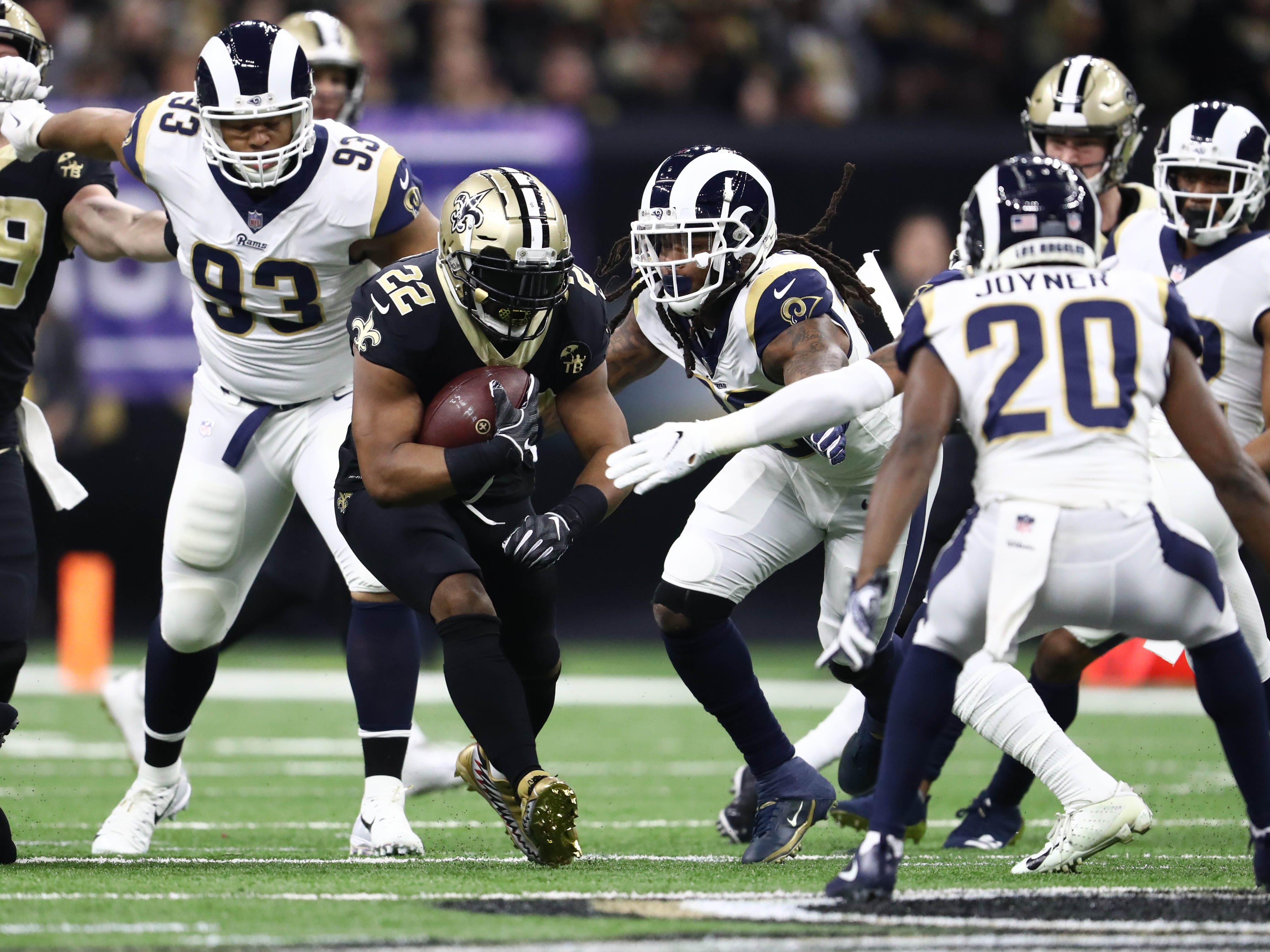 New Orleans Saints running back Mark Ingram (22) runs the ball against the Los Angeles Rams during the first quarter in the NFC Championship game at Mercedes-Benz Superdome.
