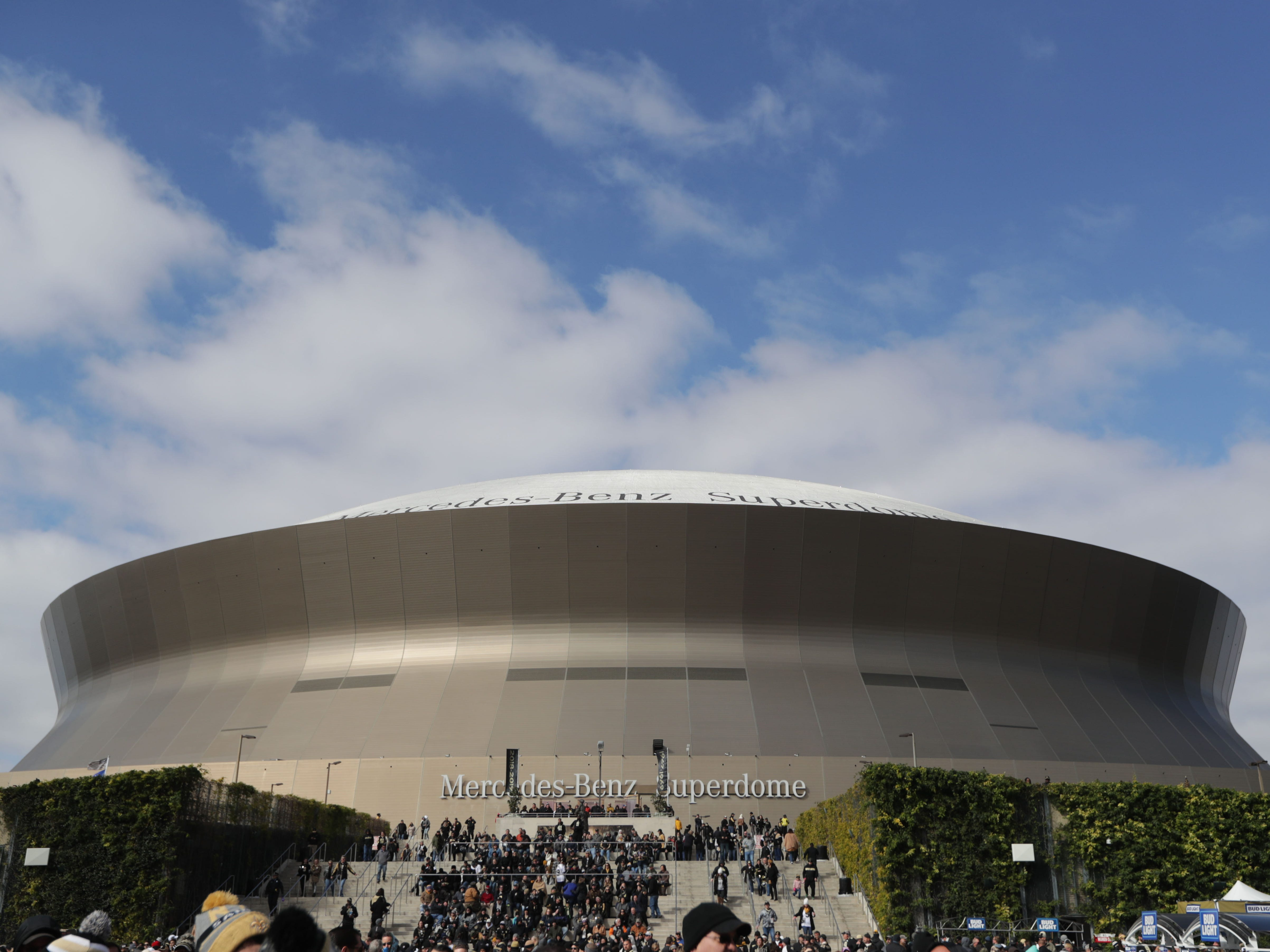 Fans wait outside the Mercedes-Benz Superdome before the NFC Championship game between the New Orleans Saints and the Los Angeles Rams.