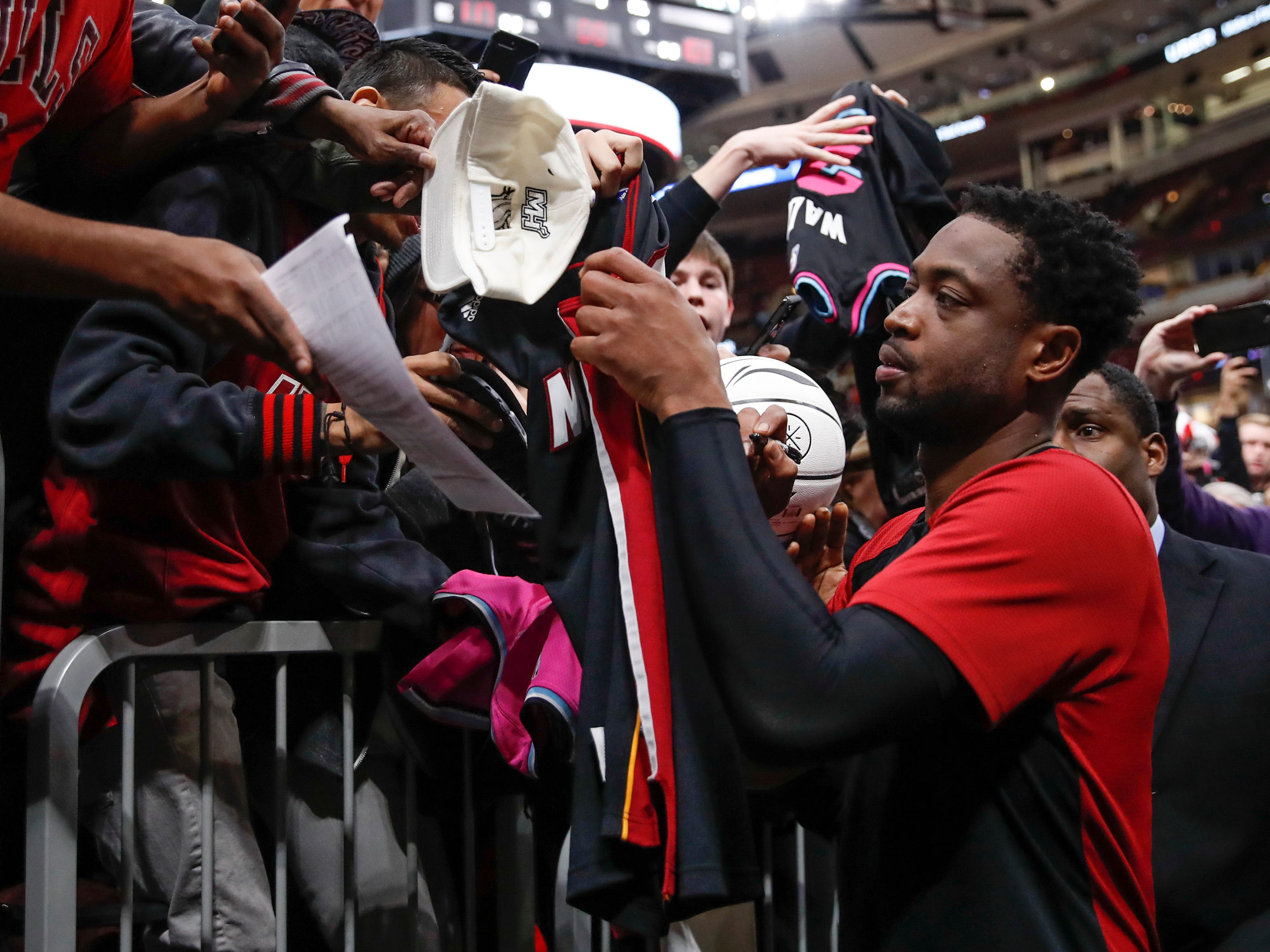 Jan. 19: Retiring Heat guard Dwyane Wade signs autographs after his final game in his hometown of Chicago.