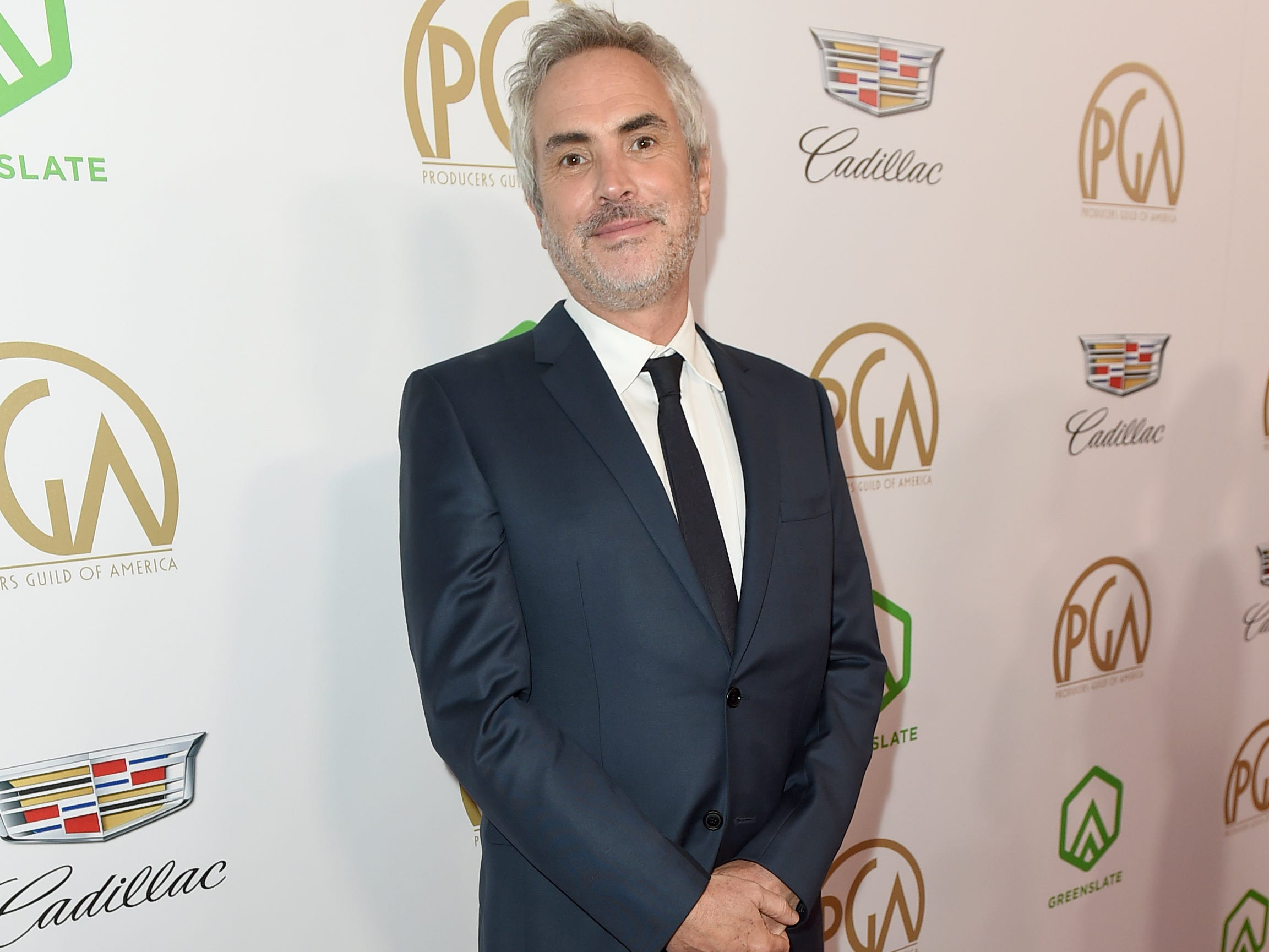 IMAGE DISTRIBUTED FOR PRODUCERS GUILD OF AMERICA - Alfonso Cuaron arrives at the 30th Producers Guild Awards presented by Cadillac at the Beverly Hilton on Saturday, Jan. 19, 2019, in Beverly Hills, Calif. (Photo by Jordan Strauss/Invision for Producers Guild of America/AP Images) ORG XMIT: CALB123