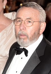 """Former CIA operative Tony Mendez arrives on the red carpet for the 85th annual Academy Awards in 2013, where """"Argo"""" won best picture."""