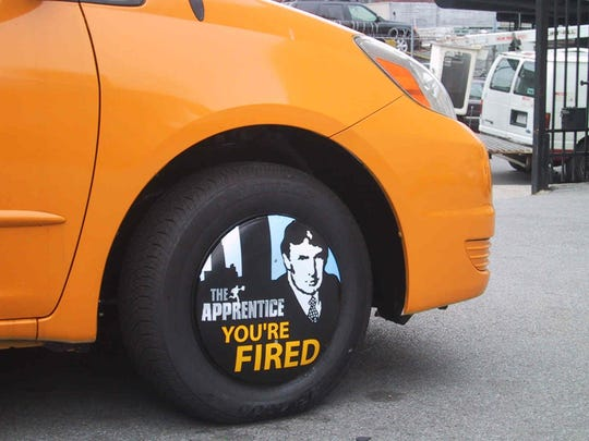 AdFleet wheel cover features Donald Trump from his reality TV show 'The Apprentice,' July 16, 2004.