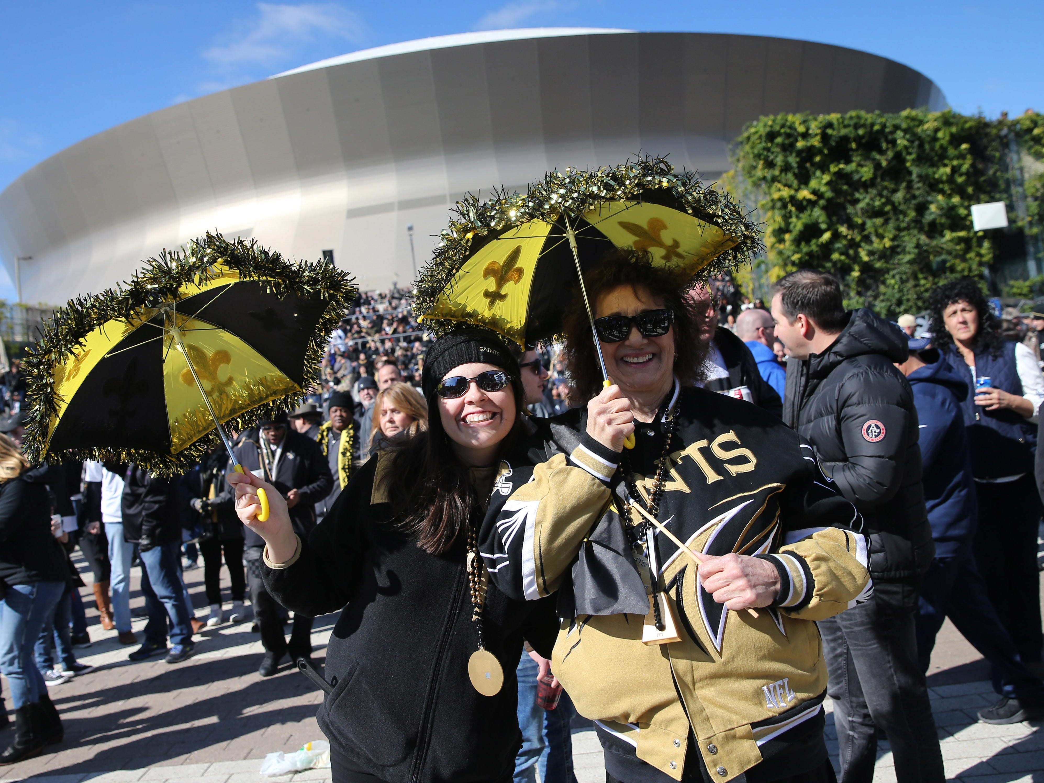 New Orleans Saints fans Erin Patin and Jackie Gondrella of New Orleans pose outside the Mercedes-Benz Superdome before the NFC Championship game between the Saints and the Los Angeles Rams.