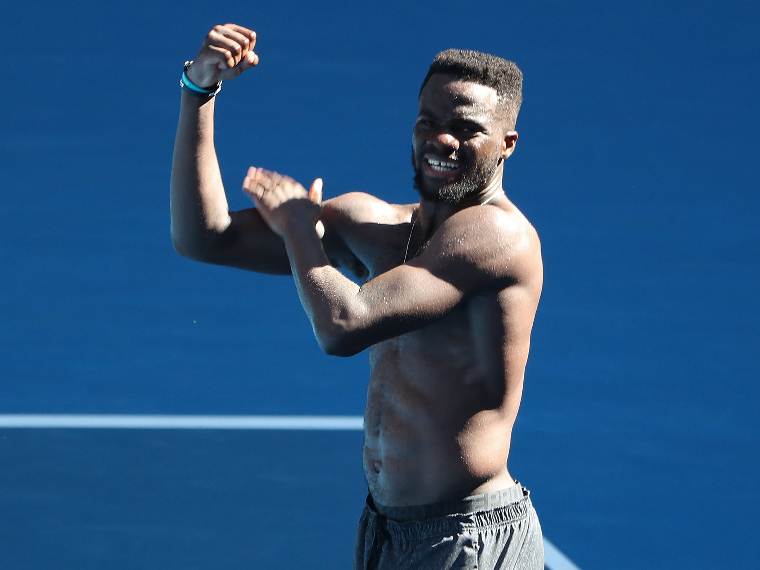 Frances Tiafoe celebrates after upsetting Grigor Dimitrov to advance to the quarterfinals.