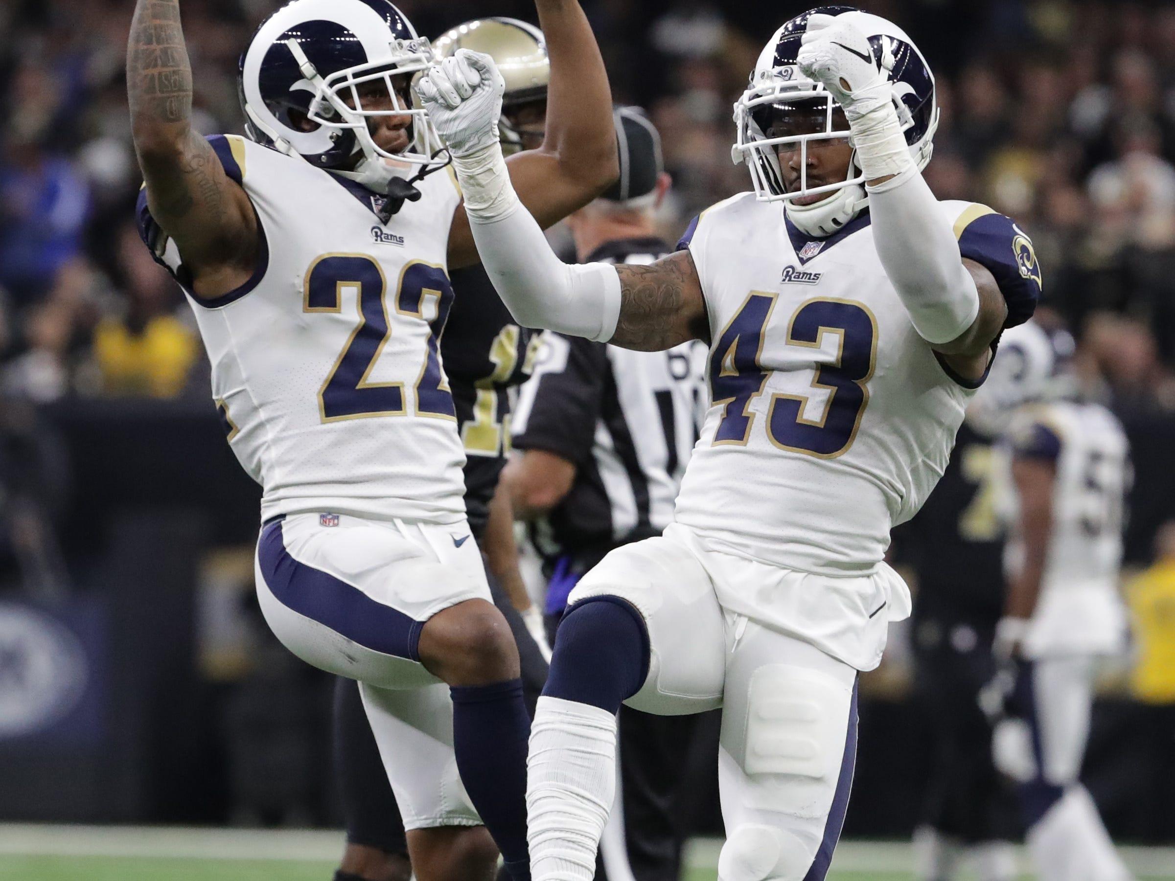 Los Angeles Rams cornerback Marcus Peters (22) and strong safety John Johnson (43) celebrate during overtime in the NFC Championship Game against the New Orleans Saints.