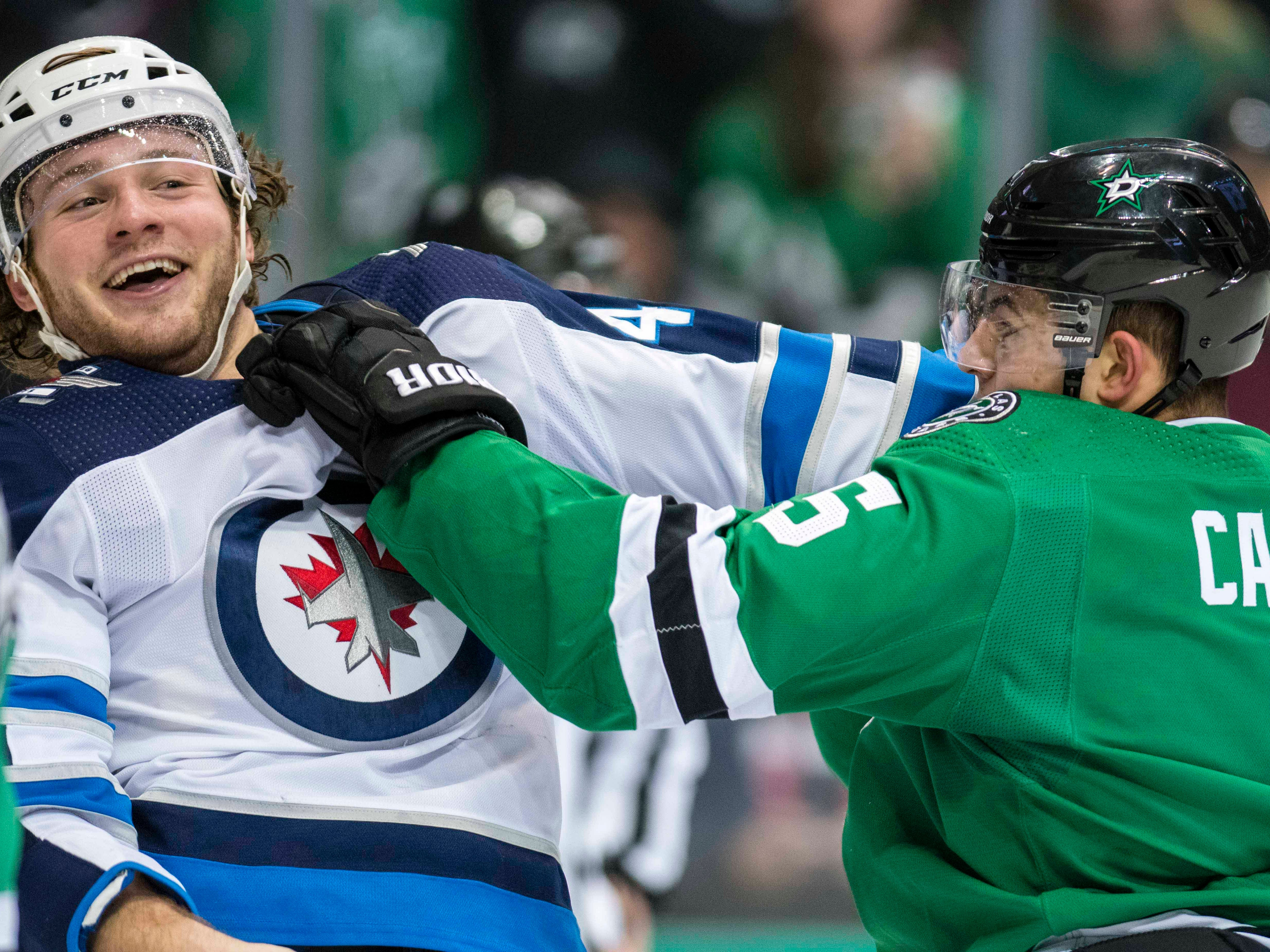 Jan. 19: Winnipeg Jets' Brendan Lemieux vs. Dallas Stars' Connor Carrick.